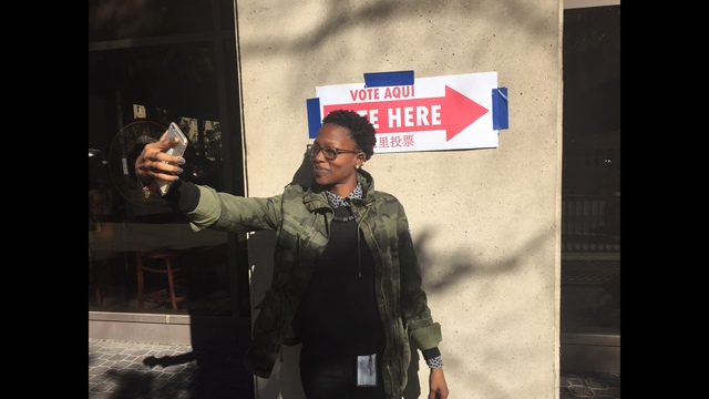 Early voter snaps a selfie after casting an early vote in Washington, DC. (Photo_ Chance Seales)_186993
