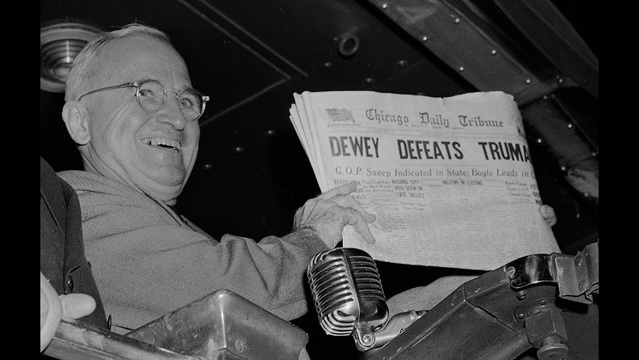U.S. President Harry S. Truman holds up an Election Day edition of the Chicago Daily Tribune, which, based on early results, mistakenly announc_186904