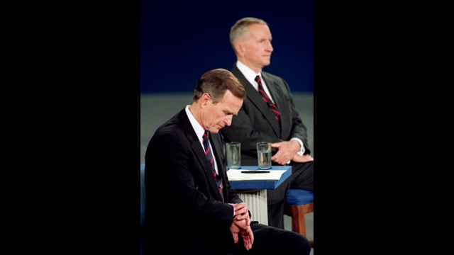 In this Oct. 15, 1992 file photo President George H.W. Bush looks at his watch during the 1992 presidential campaign debate with other candidat_187315