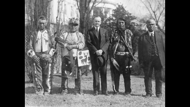 U.S. President Calvin Coolidge with four Osage Indians after Coolidge signed the bill granting Indians full citizenship._187498