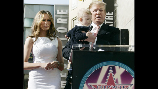 Donald Trump, his wife, Melania, and their son, Barron, pose for a photo after he was honored with a star on the Hollywood Walk of Fame in Los _187815