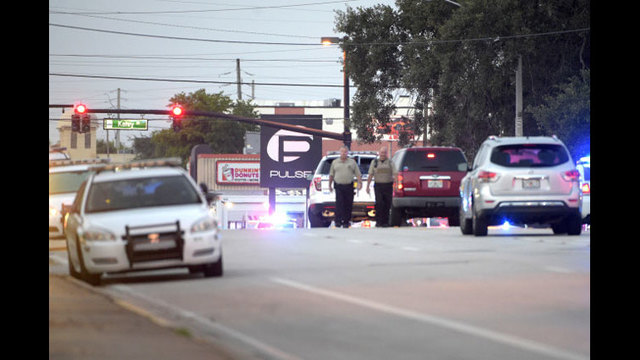 Police cars surround the Pulse Orlando nightclub, the scene of a fatal shooting, in Orlando, Fla., Sunday, June 12, 2016. (AP Photo_Phelan M. E_174387