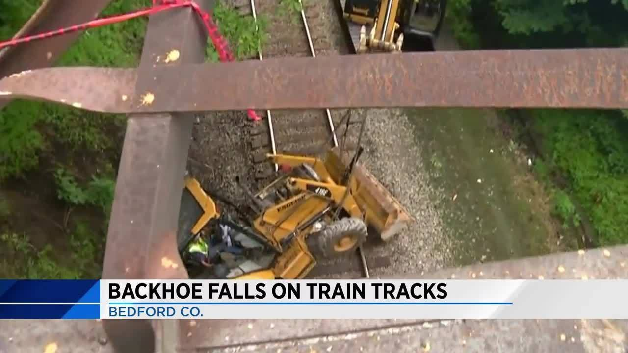 Man charged after backhoe falls over bridge, gets hit by