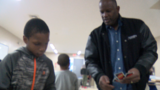 Liberty football coach spends time with children in low-income community