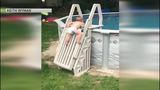 Parents remind others about pool safety after recording son climbing pool ladder