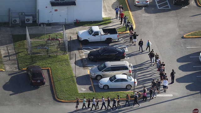 Florida deputy charged after staying outside school shooting