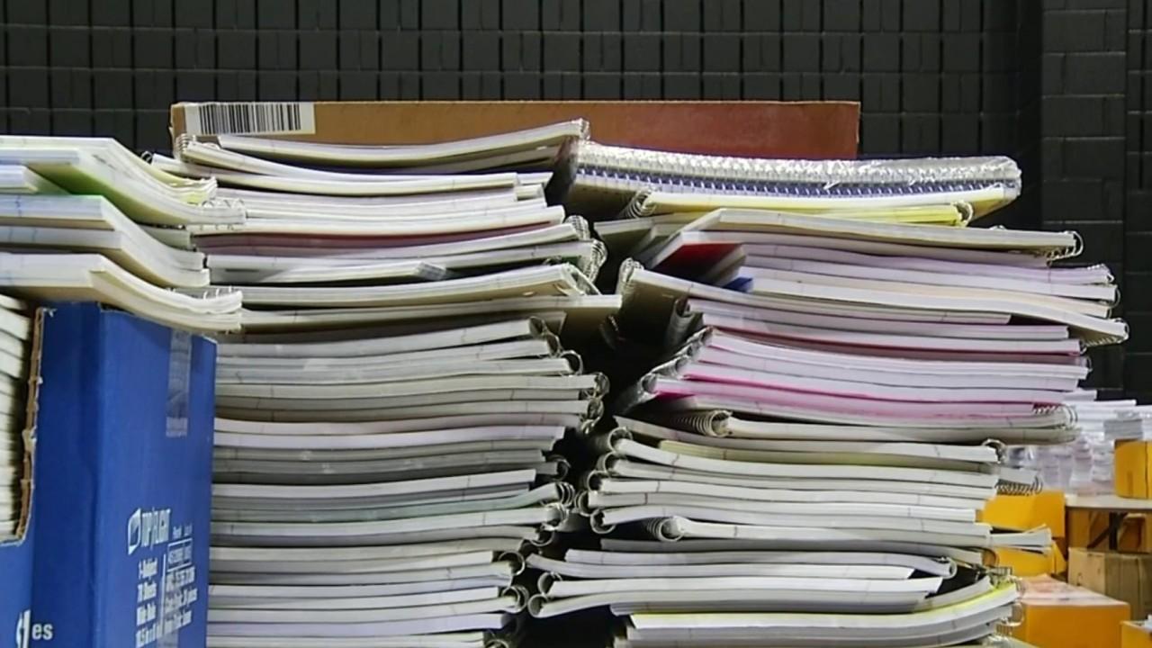 Wells Fargo employees sort school supplies