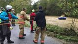Swift-water crews rescue students, driver from stranded bus