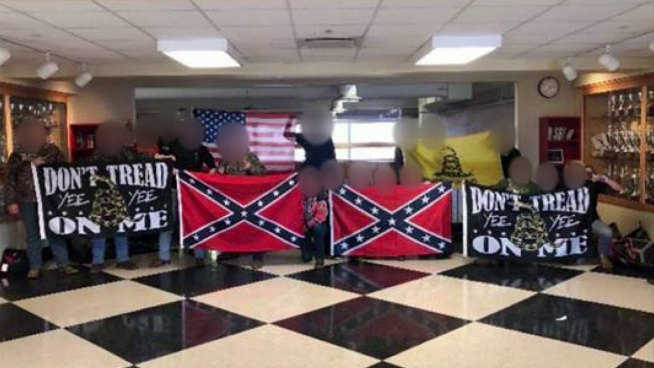 Pictures of Confederate flags paraded at Jefferson Forest