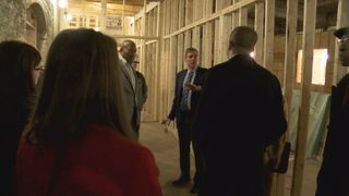 Sen. Mark Warner tours revitalization in Danville's River District