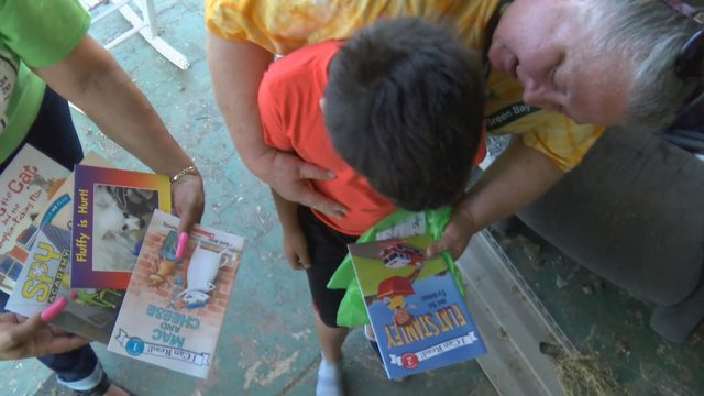 Henry County teachers deliver books to students for summer