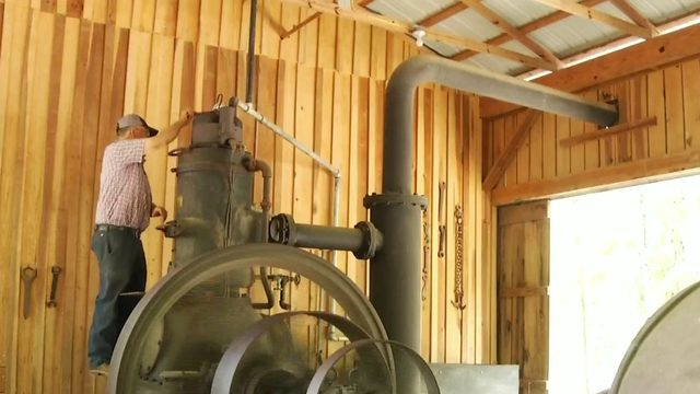 Old engine, 10 feet tall, featured at Antique Farm Days