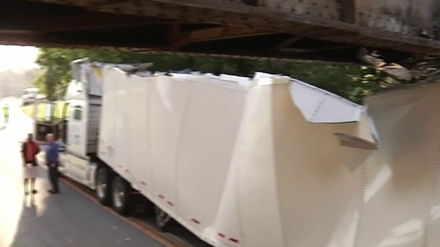 Police ticket tractor-trailer driver who got stuck under Roanoke train trestle