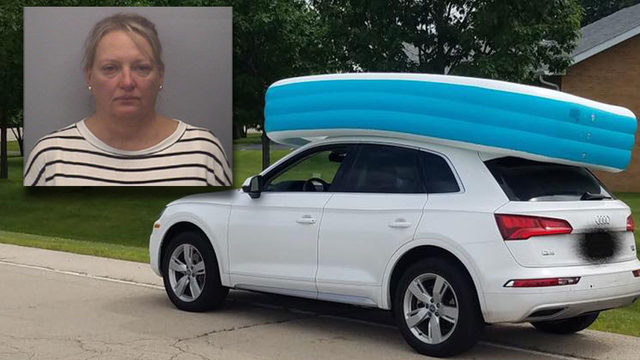 Mom arrested after girls spotted riding in pool on SUV's roof, police say