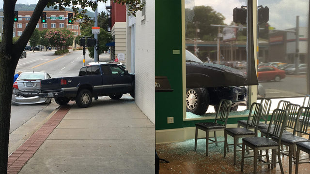 One charged, another hospitalized after truck crashes into downtown…