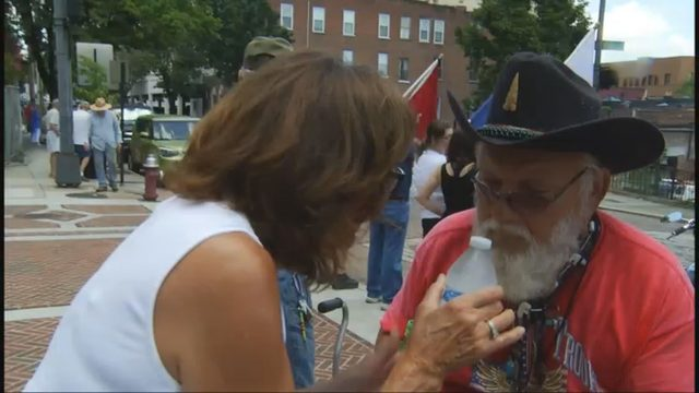 Good Samaritan hands out water to veterans outside supporting troops