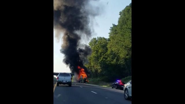 RV on fire on side of road