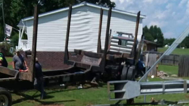 One hospitalized after tractor-trailer crashes into Halifax County home
