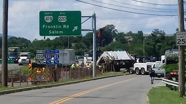 Woman taken to hospital after garbage truck overturns on 220 N in Roanoke