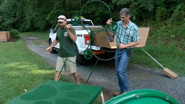 One year after flood damage, Lynchburg dog park installs new agility course
