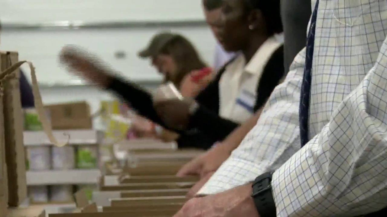 Kroger employees pack meals to 'Feed The Hungry'