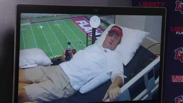 Hugh Freeze coached from hospital bed in the box on Saturday