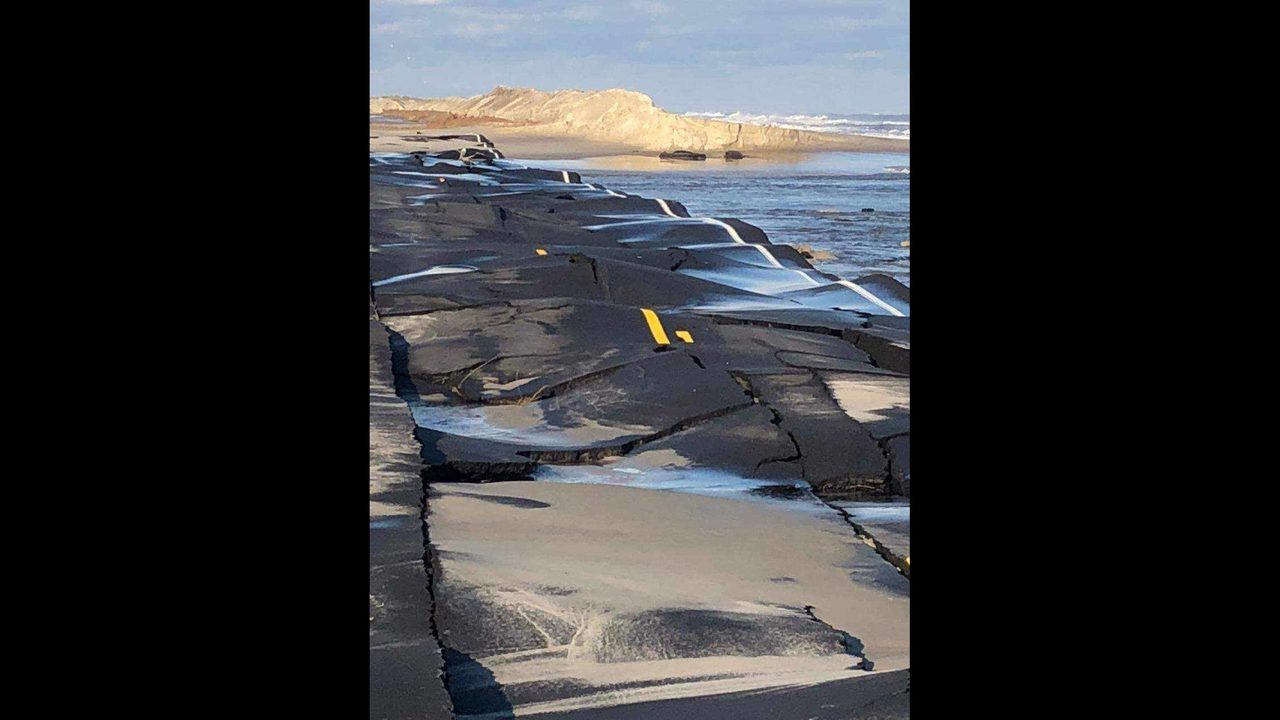 Highway warped by excessive flooding and erosion after