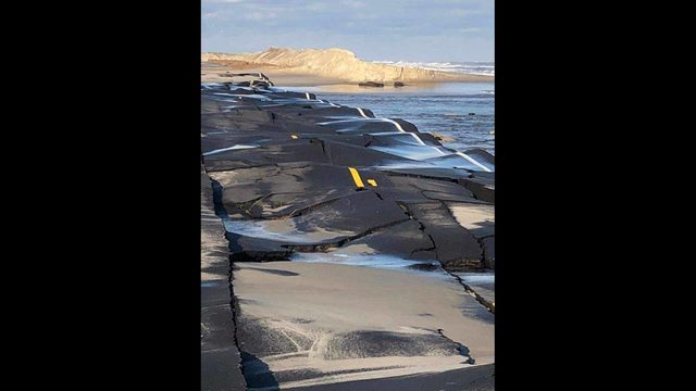 Highway warped by excessive flooding and erosion after Hurricane Dorian
