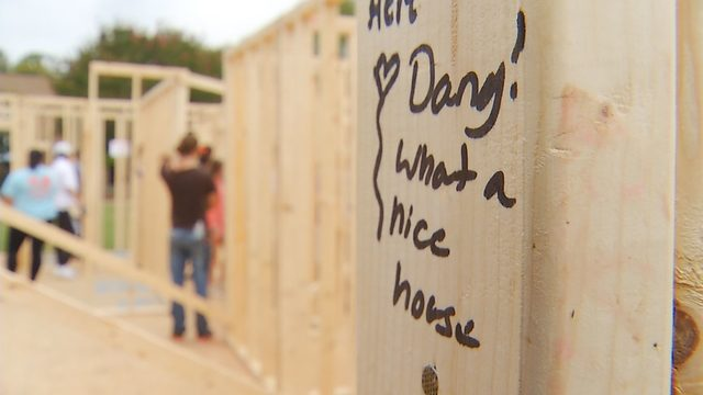 More than 100 college students help build Habitat for Humanity house