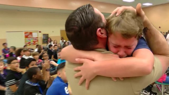 Navy dad surprises kids at school after return from Iraq