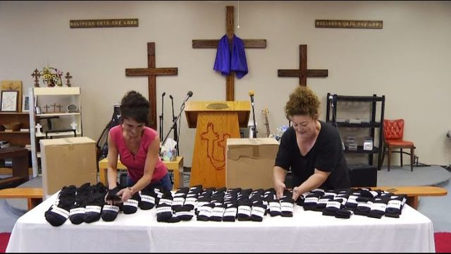 Roanoke's Chicken Church distributes high end socks to those in need