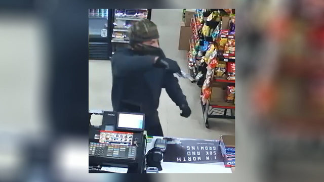 Police search for 'armed and dangerous' man who robbed convenience store…