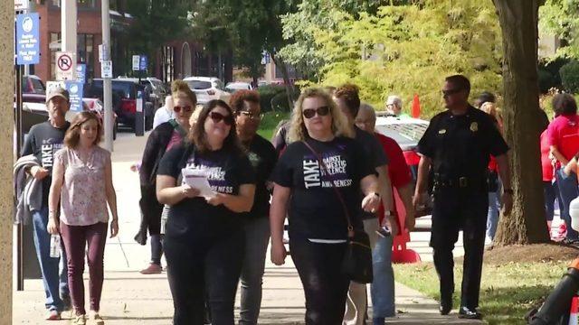 Dozens walk in Roanoke to raise awareness for domestic violence