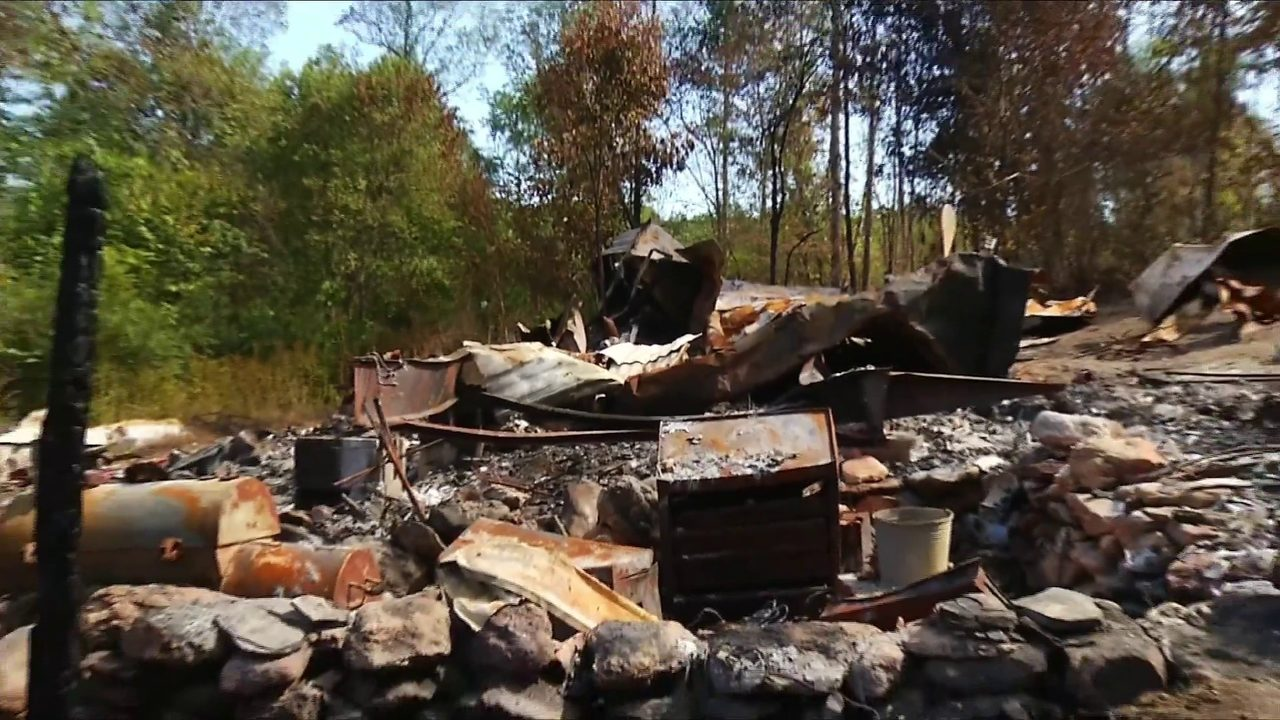 Couple loses home to fire, moves into tents on their Henry County property