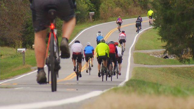Hundreds of cyclists, including 10 News' John Carlin, ride for…