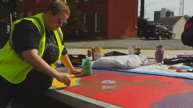Artists paint Lynchburg storm drains to encourage environmental awareness