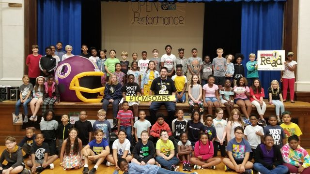 Local students surprised by NFL players, encouraged to keep head in books